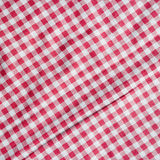 Checkered picnic tablecloth. Red and white checkered fabric texture. Red picnic tablecloth background Stock Photos