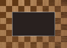 Checkered picture frame. Checkered square wooden picture frame with room for your own image Royalty Free Stock Image