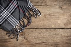 Checkered plaid on wooden. Vintage checkered plaid on wooden background, copy space royalty free stock photos