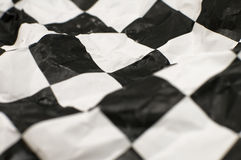 Checkered race flag. Wrinlked checkered race paper flag, shallow depth of view Stock Image