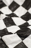 Checkered race flag. Wrinlked checkered race flag, shallow depth of view Stock Photos