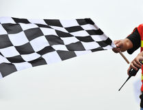 Checkered racing flag. Checkered race flag in hand stock photos