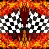 Checkered racing flag on fire Royalty Free Stock Photography