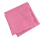 Checkered red and white napkin or folded tablecloth isolated on. White background, clipping path Stock Image