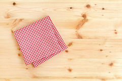 Checkered red and white napkin or folded tablecloth on wooden ba. Checkered red and white napkin or folded tablecloth on wood background with copy space Stock Images