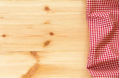 Checkered red and white napkin or folded tablecloth on wooden ba Stock Photo