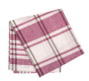Checkered with red and white tablecloth. Isolated over white background Royalty Free Stock Images