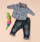 Checkered shirt and blue jeans for little boys Stock Photography