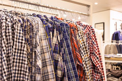 Checkered Shirts on the Store Rack. Clothing in Fashion Store - Checkered Men Shirts on the Store Rack Stock Images