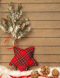 Checkered star on wooden background Stock Photo
