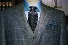 Checkered Suit, Blue Shirt, Tie (Horizontal). Mannequin in gray checkered suit, blue shirt, dark tie and handkerchief Royalty Free Stock Photo