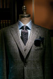 Checkered Suit, Blue Shirt and Tie (Vertical). Mannequin in gray checkered suit, blue shirt, dark tie and handkerchief Royalty Free Stock Image
