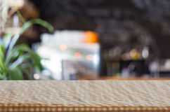 checkered table cloth on empty table and restaurant or cafe for Stock Photos