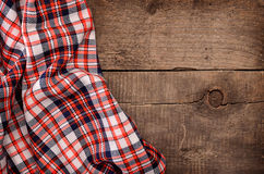 Checkered table cloth on wood Stock Images