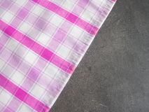 Checkered tablecloth on stone counter top in the kitchen Royalty Free Stock Images