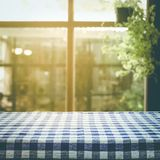 Checkered tablecloth texture top on blur of window background Royalty Free Stock Photo