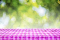 Checkered tablecloth texture top view on abstract green backgrou Royalty Free Stock Photography