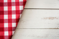 Checkered tablecloth on a white wooden background Royalty Free Stock Photo
