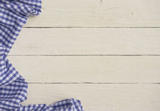 Checkered tablecloth on wood Stock Photos