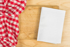 Checkered Tablecloth on wooden background. Checkered Tablecloth Textile on Wooden Background Texture with Blank Notebook Recipe Page Stock Image
