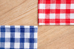 Checkered tablecloth on wooden table. The checkered tablecloth on wooden table Royalty Free Stock Image