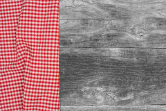 The checkered tablecloth on wooden table Stock Image