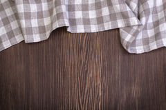 Checkered tablecloth on wooden table Royalty Free Stock Images