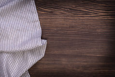Checkered tablecloth on wooden table. Background Royalty Free Stock Photography
