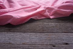 The checkered tablecloth on wooden table background.  Stock Image