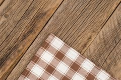 The checkered tablecloth on wooden table. Top view Stock Photos