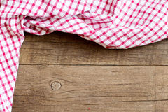 Checkered tablecloth on wooden table Stock Images