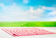 The checkered tablecloth on wooden table. Red checkered tablecloth on wooden table stock image