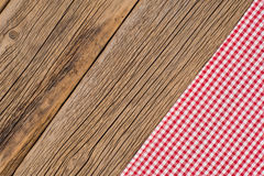 The checkered tablecloth on wooden table. Top view Stock Photo