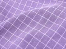 Checkered violet fabric. Pleated checkered violet fabric closeup. Good for background Royalty Free Stock Photo