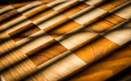 Checkered Wood Design with Crossing Shadows Stock Images