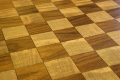 Checkered wooden floor. Brown and tan checkered wooden floor stock photography
