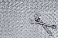 Checkerplate And Wrenches Background Royalty Free Stock Photography