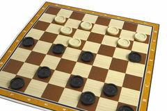Checkers. A game of checkers or draughts Royalty Free Stock Image