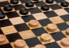 Checkers. Board game with first move stock images