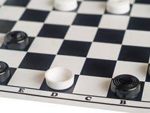 Checkers on board Stock Photos
