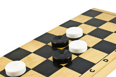 Checkers on the board. Stock Photo
