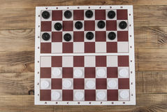 Checkers on the board stock photo