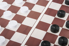Checkers on the board royalty free stock images