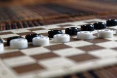 Checkers in checkerboard ready for playing. Game concept. Board game. Hobby. checkers on the playing field for a game. royalty free stock photos
