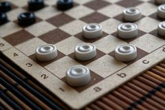 Checkers in checkerboard ready for playing. Game concept. Board game. Hobby. checkers on the playing field for a game. stock image