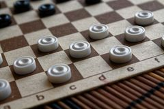 Checkers in checkerboard ready for playing. Game concept. Board game. Hobby. checkers on the playing field for a game. royalty free stock photography