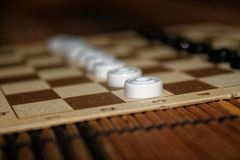 Checkers in checkerboard ready for playing. Game concept. Board game. Hobby. checkers on the playing field for a game. Checkers in checkerboard ready for stock images