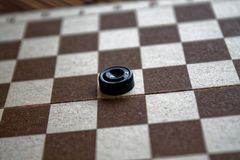 Checkers in checkerboard ready for playing. Game concept. Board game. Hobby. checkers on the playing field for a game. Checkers in checkerboard ready for royalty free stock image