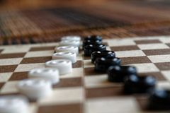 Checkers in checkerboard ready for playing. Game concept. Board game. Hobby. checkers on the playing field for a game. Checkers in checkerboard ready for stock photo