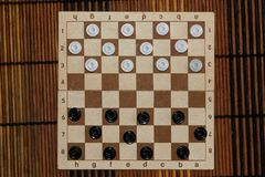 Checkers in checkerboard ready for playing. Game concept. Board game. Hobby. checkers on the playing field for a game. Checkers in checkerboard ready for royalty free stock photography